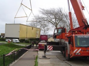 Removal of Old Changing Room Cabin By Crane